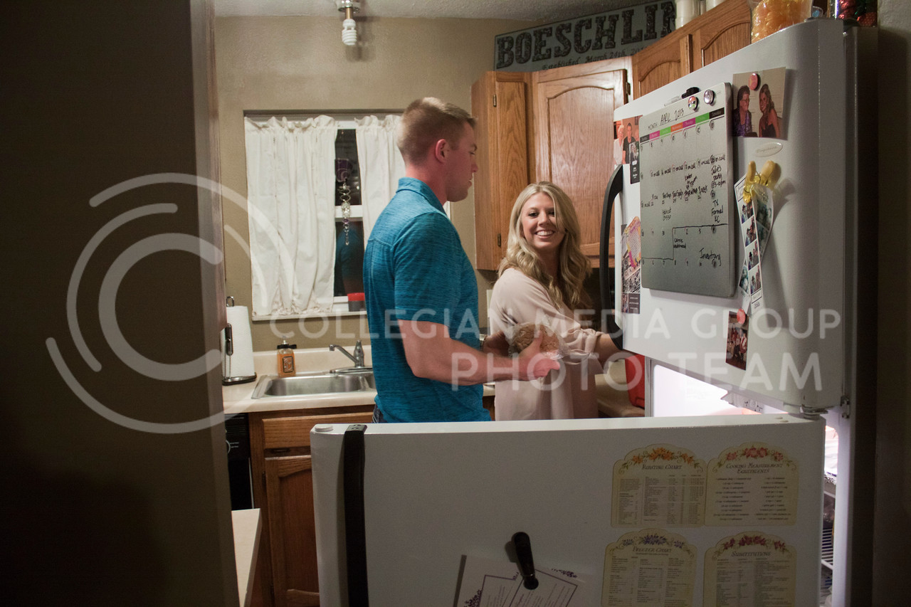 Mandy Boeschling helps her husband, 2nd Lt. Nicolas Boeschling, put the finishing touches on his lunch for the following workday at Fort Riley on March 1, 2013. Nicolas was an active member of the military, serving as Second Lieutenant.