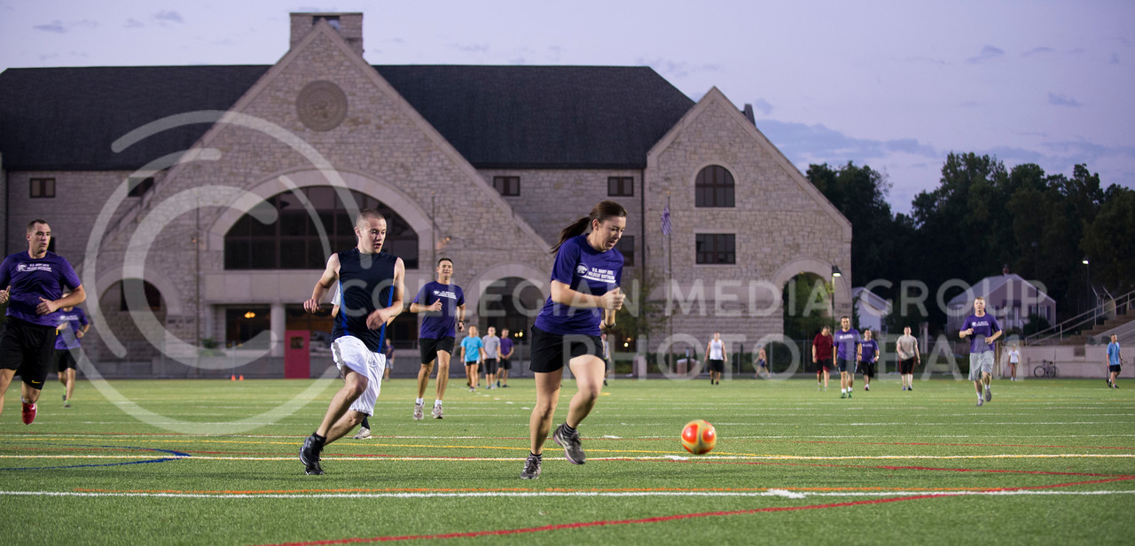 Megan Walden, senior in indusrial engineering, charges down the field in a game of flicker ball as part the Army ROTC physical training in Memorial Stadium on Sept. 18, 2013.