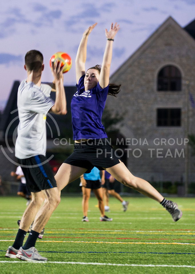 Megan Walden, senior in indusrial engineering, attempts to block a pass in a game of flicker ball as part the Army ROTC physical training in Memorial Stadium on Sept. 18, 2013.  Walden, was one of eight cadets in the Wildcat Battalion to earn the highest rating possible during summer ROTC training.