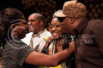 Chandrika Brewton, newly crowned Miss Black and Gold, is congratulated by her parents.