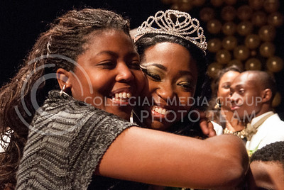 Chandrika Brewton, newly crowned Miss Black and Gold, is embraced by her mother.