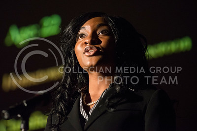 Kabila Gana introduces herself at the beginning of the Miss Black and Gold pageant on Dec. 7, 2013, in Forum Hall.