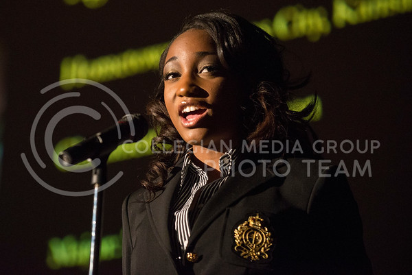Katheryne Johnson introduces herself at the beginning of the Miss Black and Gold pageant on Dec. 7, 2013, in Forum Hall.