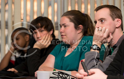 (from right) Tim Relihan, Manhattan resident, Katie Gentry, senior in chemistry and bio-chemistry, Trevor Steiner, junior in biology pre-med, and Adam White, Manhattan resident, consider a literature question during Quiz Bowl practice in the Union on March 25.