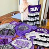 "Parker Robb | The Collegian<br /> <br /> Erin Stoskopf, senior in apparel and textiles marketing, and owner of ""Stostyles,"" creates hand-crafted gameday apparel for K-State fans, including dresses, sweatshirts, tanks and bandeaus, as well as for fans of KU, Mizzou, Nebraska and Oklahoma."