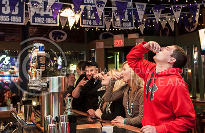 A group of friends do shots at the bar at Kite's on Saturday, March 29. Business Insider named Kite's Grille & Bar one of the best college bars in the U.S.