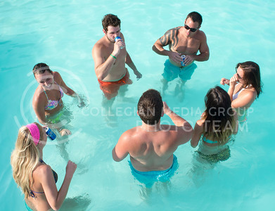 Photo by George Walker | The Collegian  A group of pool-goers cool off in the pool at University Crossing on Monday, July 21. The temperature Monday hit a high of 105°.