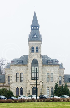 Photo by Parker Robb | The Collegian  Anderson Hall, the centerpiece of the K-State campus, looms through the mist on a grey, rainy day April 3, 2014.