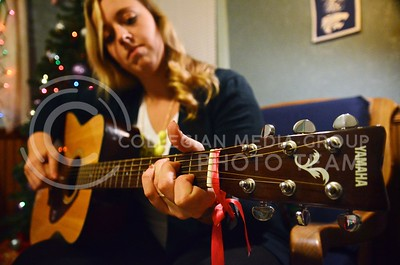 (Photo by Parker Robb | Collegian)  Macy Warburton, senior in political science, started playing guitar six years ago when she learned for a mission trip, found a greater purpose in playing, and hasn't stopped playing for enjoyment.