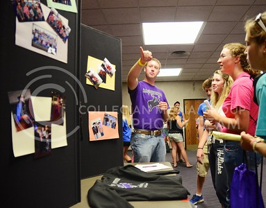 (Photo by Parker Robb | Collegian)  Seth Bredemeier, senior in animal science, tells  Jackie Neville, junior in agricultural economics (in pink), and Brooke Boyington, freshman in fashion, apparel and textile design, about some of the various activities which members of the K-State Rodeo Club do during the Union Expo and Activities Carnival Aug. 29 in the K-State Student Union. K-State students flocked to the expo, which filled the concourses on the first and second floors, as well as the Grand Ballroom, to browse the displays and learn about various student organizations and clubs.