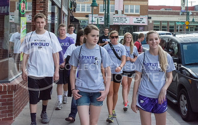 Photo by George Walker | Collegian  A group of incoming freshman tour Aggieville during Wildcat Warmup.