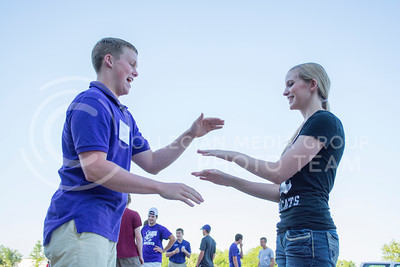 Incoming freshman Andrew McKittrick and Taylor Ireland practice a handshake they will perform throughout Wildcat Warmup. McKitrick chose K-State because 'it's so much more personal than any other place.'