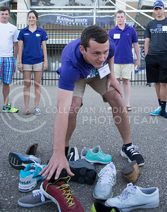 Photo by George Walker | Collegian  Kyle Saunder, incoming freshman, picks up a shoe during an icebreaker on the first day of Wildcat Warmup. There are two more sessions of Wildcat Warmup this Summer.