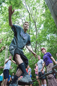 Photo by George Walker | Collegian  Incoming freshman Alex Westrope balances on a wire at the K-State Challenge Course during Wildcat Warmup. The K-State Challenge Course offers team-building activities to groups and is especially helpful to college freshman.