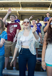 Photo by George Walker | Collegian  Incoming freshman Carly Benjamin claps for the end of the Wabash during Wildcat Warmup. The incoming freshman learned several K-State tradtions, such as the Wabash and the Alma Mater.