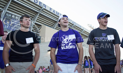 Photo by George Walker | Collegian  Brady Myers, Eric Banzhaf, and Eric Gessler chant 'Big Booty' during an icebreaker the first day of Wildcat Warmup. Wildcat Warmup atendees went to Bill Snyder Family Stadium for a pep rally the first day of Wildcat Warmup.