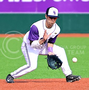 Photo by Parker Robb | The Collegian  Junior second baseman Carter Yagi catches a grounder before throwing it to first for K-State's third out of the second inning in the Wildcats' defeat of Iowa March 7, 2014.