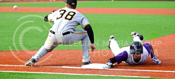 Photo by Parker Robb | The Collegian  Senior third baseman RJ Santigate slides back into first base before being tagged out by Iowa first baseman Tyler Peyton after attempting to steal second in the fifth inning of the Wildcats' 3-2 defeat of Iowa in the first game of the series March 7, 2014.