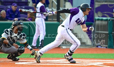 Photo by Parker Robb | The Collegian  Senior third baseman RJ Santigate hits a single to center field in the fifth inning of the Wildcats' 3-2 defeat of Iowa in the first game of the series March 7, 2014.
