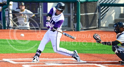 Photo by Parker Robb | The Collegian  Redshirt junior Shane Conlon hits a pop fly to left field in the second inning of the Wildcats' 3-2 defeat of Iowa March 7, 2014, at Tointon Family Stadium.