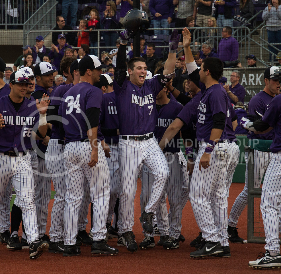 (Photo by Taylor Alderman | Collegian)<br /> <br /> Ross Kivett, senior infielder, celebrates with his team after his home run on April 18, 2014 at Tointon Family Stadium. Kivett had two runs, one of them being his third home run of the year.