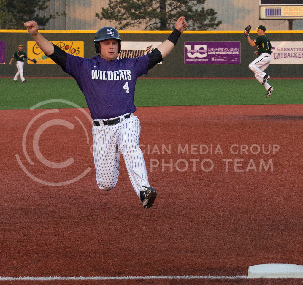 Tanner DeVinney, freshman designated hitter, slides into third base at Tointon Family Stadium. K-State defeated Baylor 6-2 on April 18, 2014 and won the series 2-1.