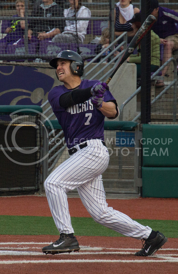 (Photo by Taylor Alderman | Collegian)<br /> <br /> Ross Kivett, senior infielder, watches his hit after striking the ball on at Tointon Family Stadium. Kivett had two runs on April 18, 2014, one of them being his third home run of the year.