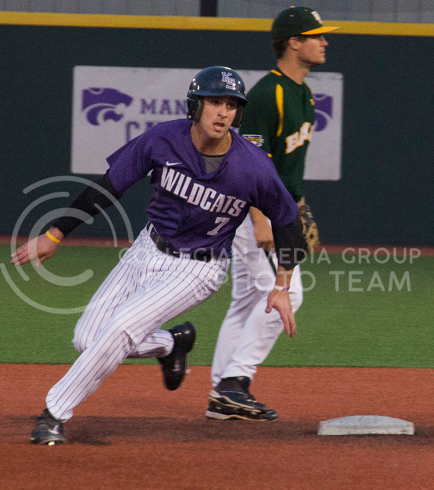(Photo by Taylor Alderman | Collegian)<br /> <br /> Ross Kivett, senior infielder, looks towards the ball as he rounds second base on April 18, 2014 at Tointon Family Stadium. K-State defeated Baylor 6-2 to capture the series.