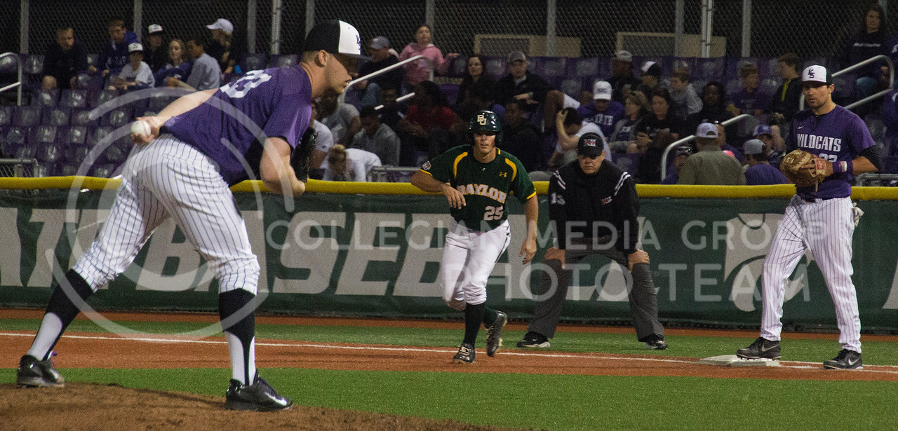 (Photo by Taylor Alderman | Collegian)<br /> <br /> Jared Moore, senior left-hand pitcher, makes his stance as Baylor's Ben Carl, the umpire, and first baseman Tyler Stover wait for him to act on April 18, 2014 at Tointon Family Stadium. K-State won the series against Baylor 2-1.