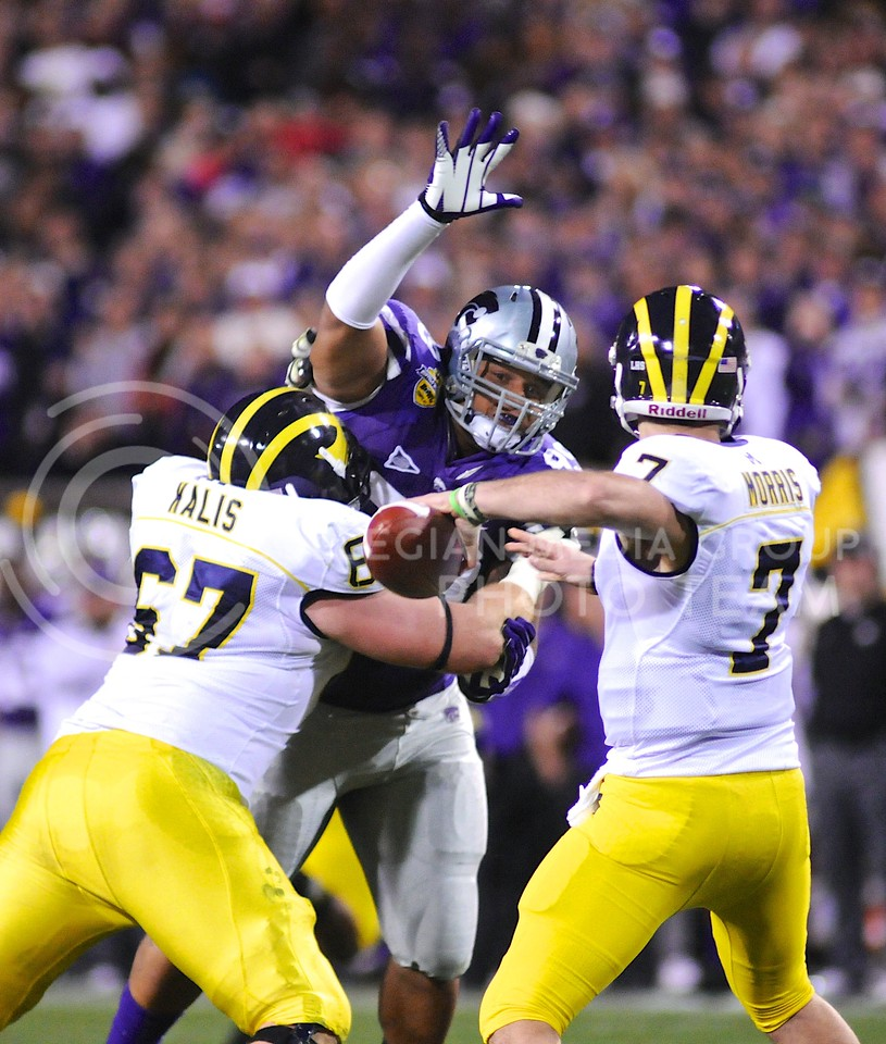 (Photo by Parker Robb   Collegian)<br /> <br /> Junior defensive tackle Valentino Coleman pressures Michigan quarterback Shane Morris in the waning minutes of the second quarter of the Buffalo Wild Wings Bowl December 28, 2013, in Tempe, Arizona.
