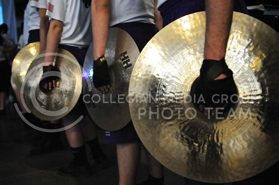 (Photo by Parker Robb | Collegian)  Members of the Pride of Wildcat Land hold cymbals at the K-State bowl game pep rally at Rawhide Western Town in Phoenix December 27, 2013.
