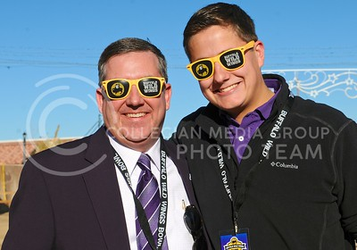 (Photo by Parker Robb | Collegian)  K-State President Kirk Schulz and son Andrew show off their Buffalo Wild Wings shades at the K-State pep rally at Rawhide Western Town in Tempe December 27, 2014.
