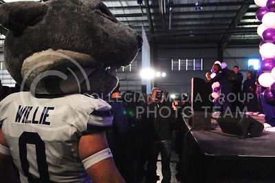 (Photo by Parker Robb | Collegian)  Willie watches as junior wide receiver Tyler Lockett talks at the K-State bowl game pep rally at Rawhide Western Town in Phoenix December 27, 2013.