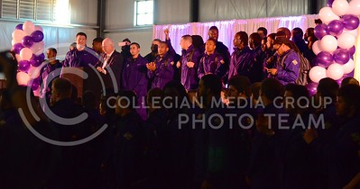 (Photo by Parker Robb | Collegian)  K-State football players fill the stage at the K-State bowl game pep rally at Rawhide Western Town in Phoenix December 27, 2013.