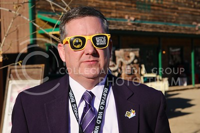 (Photo by Parker Robb | Collegian)  K-State President Kirk Schulz models a pair of Buffalo Wild Wings shades at the K-State pep rally at Rawhide Western Town in Tempe December 27, 2014.