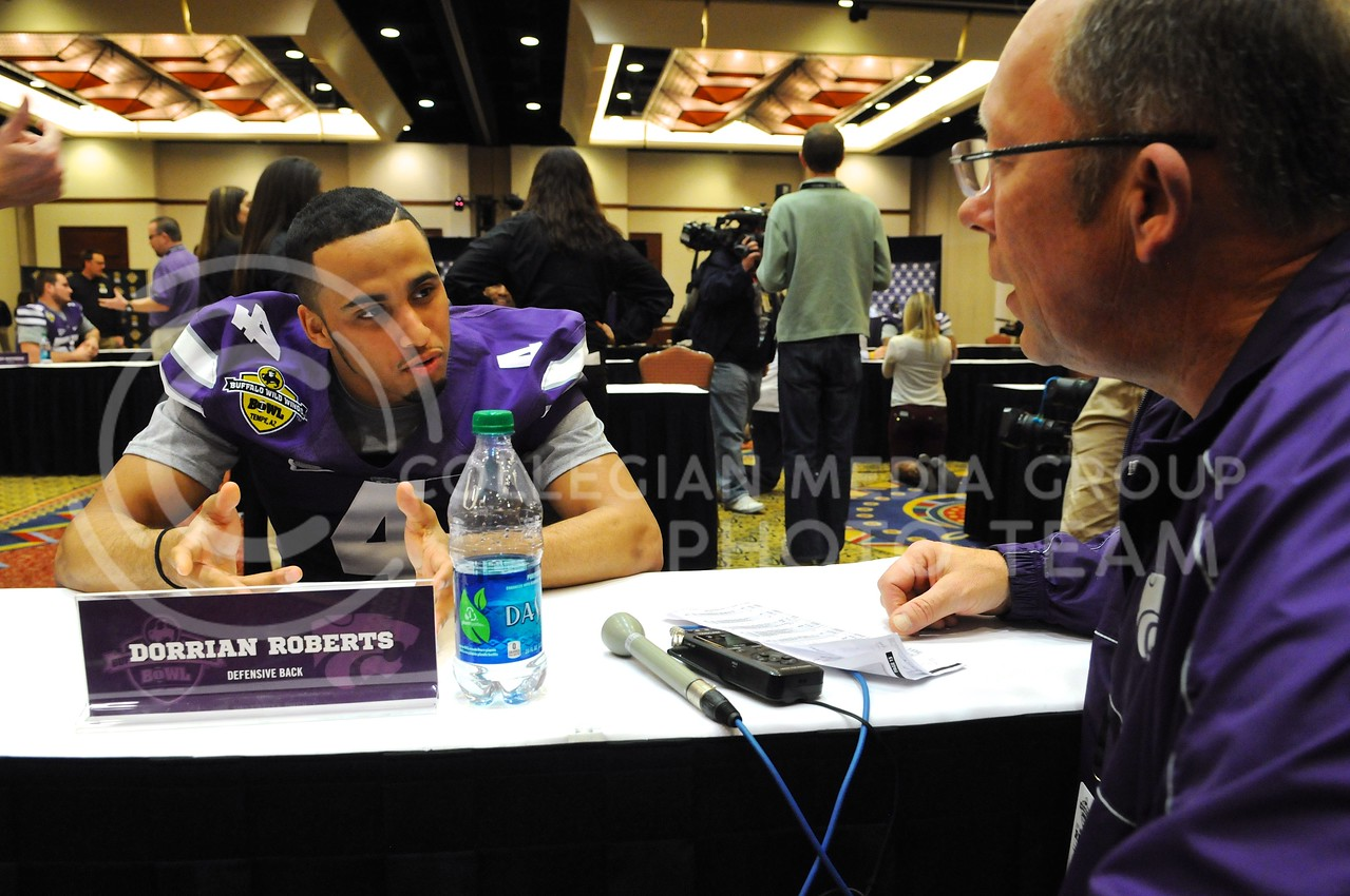 (Photo by Parker Robb | Collegian)<br /> <br /> Senior defensive back Dorian Roberts chats with Wyatt Thompson, the radio voice of the wildcats, during K-State's Buffalo Wild Wings Bowl media day December 26, 2013.