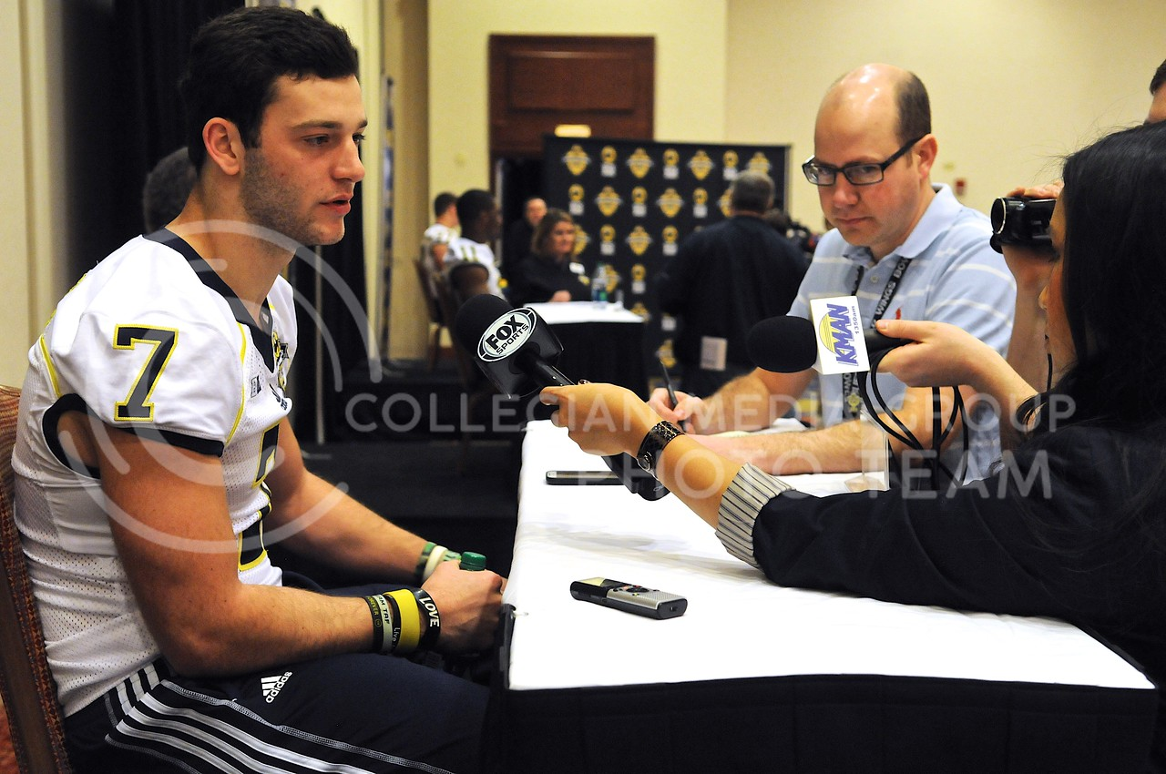 (Photo by Parker Robb | Collegian)<br /> <br /> Michigan freshman quarterback Shane Morris responds to questions from the media during Michigan's Buffalo Wild Wings Bowl media day December 26, 2013. It was announced that Morris will start at quarterback for Michigan in the Buffalo Wild Wings Bowl due to regularly-starting quarterback Devin Gardner's injuries.