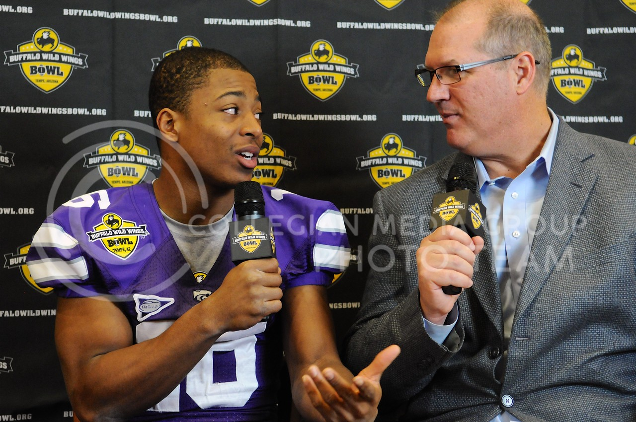 (Photo by Parker Robb | Collegian)<br /> <br /> Junior wide receiver Tyler Lockett talks with a Buffalo Wild Wings Bowl reporter about his family football heritage during K-State's Buffalo Wild Wings Bowl media day December 26, 2013.