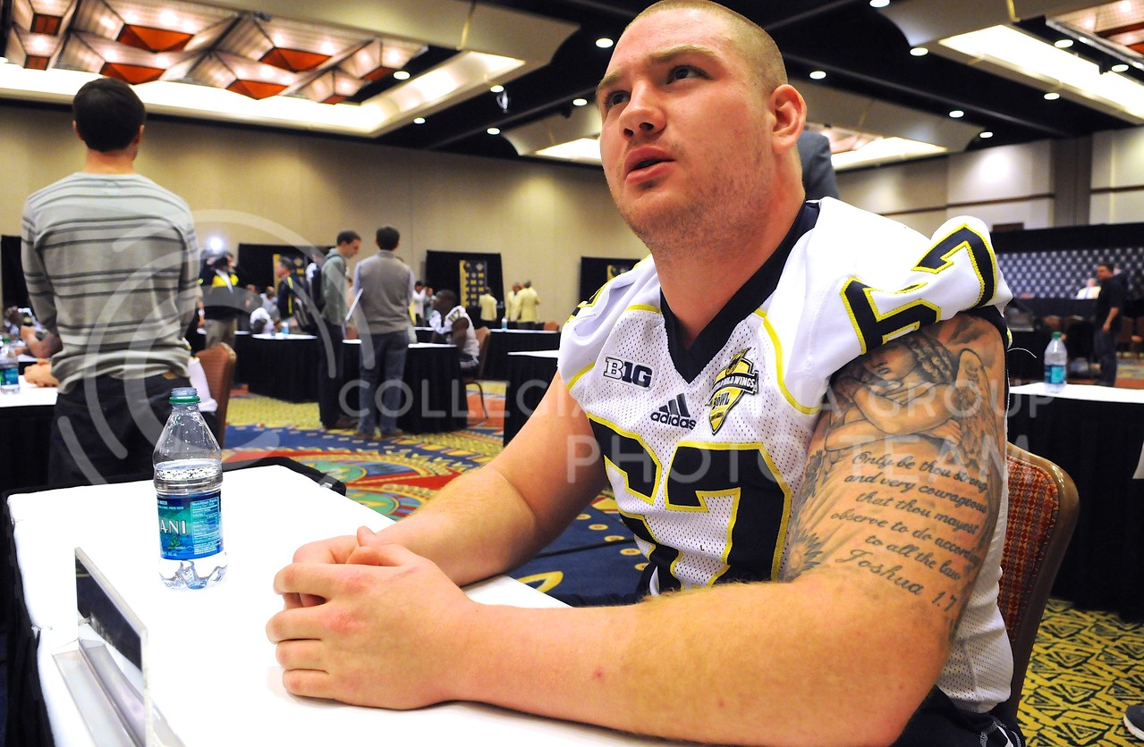 (Photo by Parker Robb | Collegian)<br /> <br /> When it comes to eating wings, Michigan players agree that right guard Kyle Kalis is the man to beat.