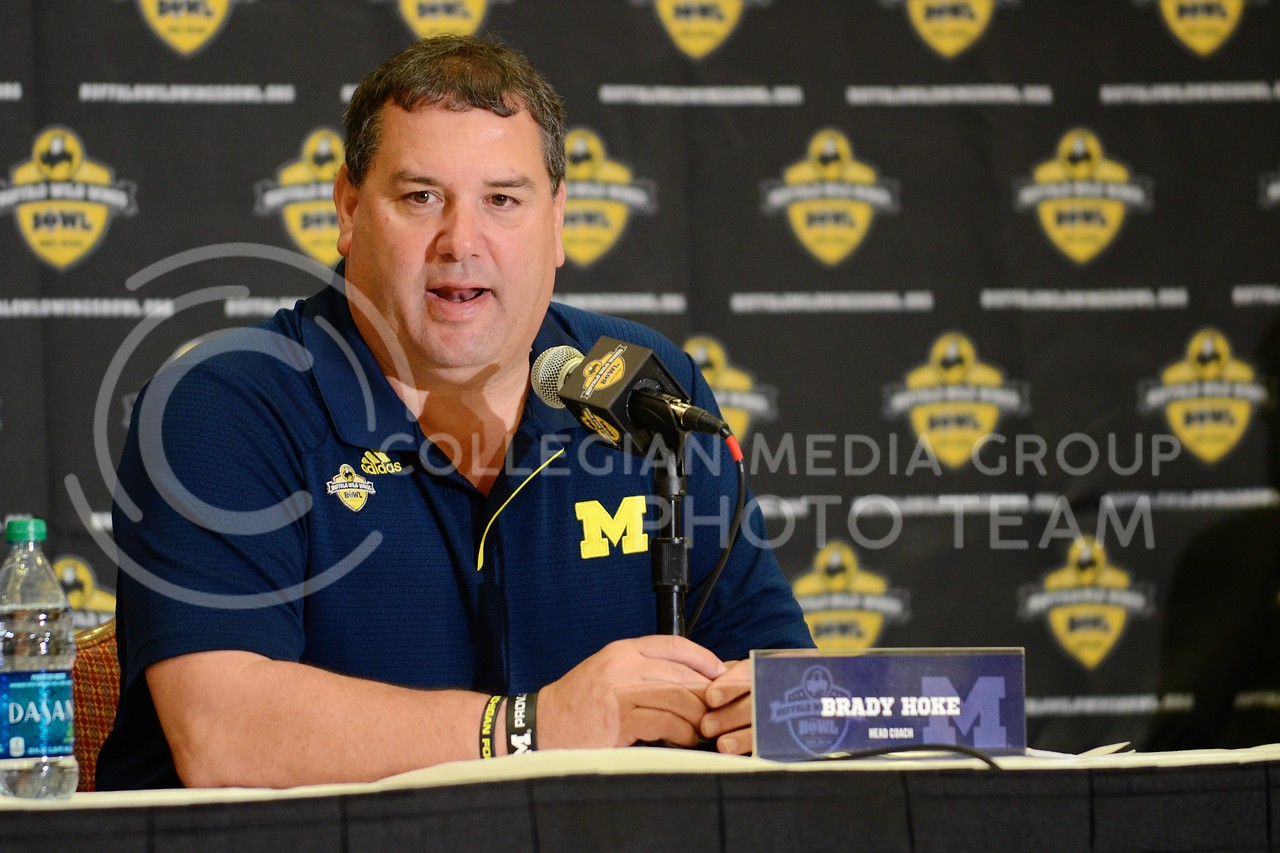 (Photo by Parker Robb | Collegian)<br /> <br /> Michigan head coach Brady Hoke responds to questions from the media during Michigan's Buffalo Wild Wings Bowl media day December 26, 2013.