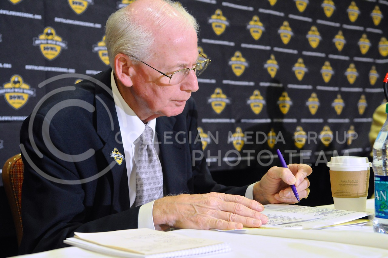 (Photo by Parker Robb | Collegian)<br /> <br /> Head coach Bill Snyder works on Buffalo Wild Wings Bowl preparation in between answering reporters' questions during K-State's Buffalo Wild Wings Bowl media day December 26, 2013.