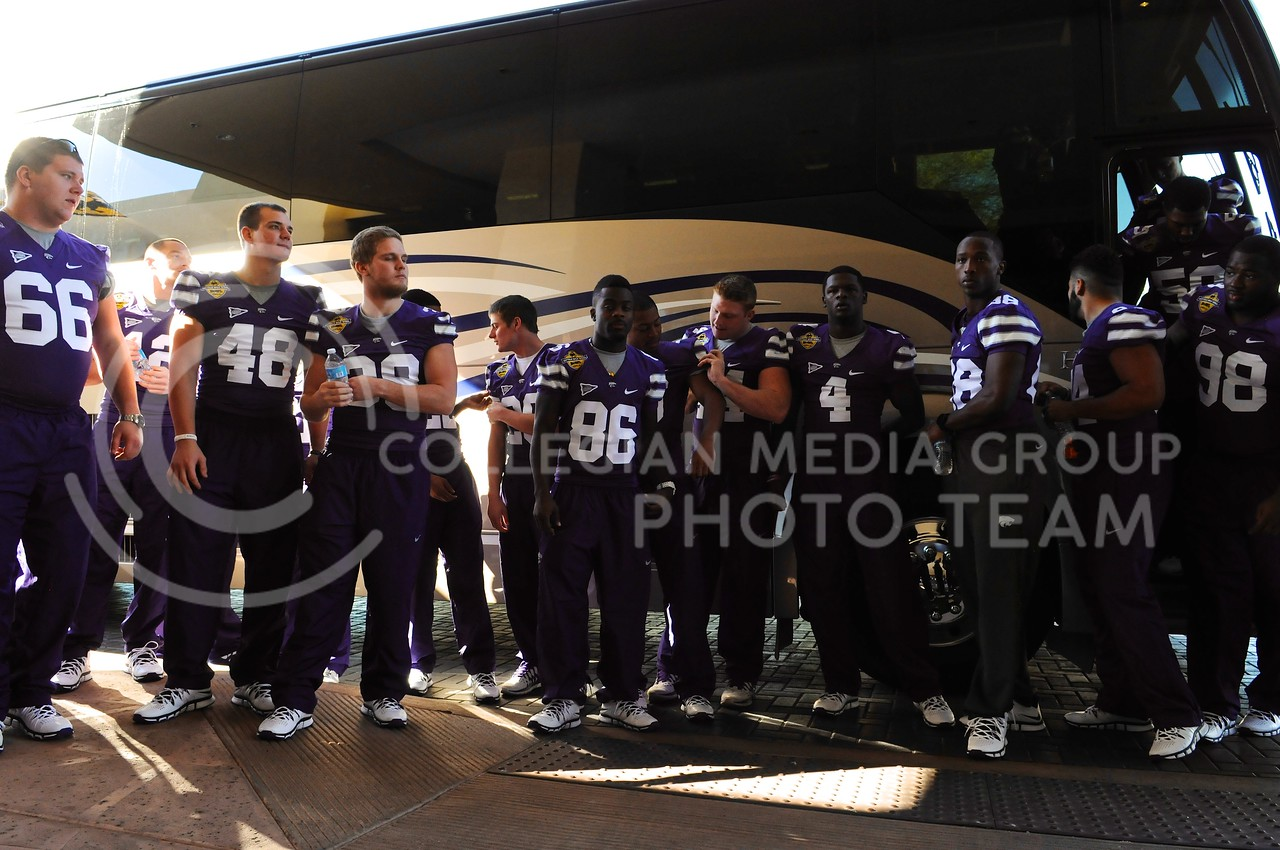 (Photo by Parker Robb | Collegian)<br /> <br /> K-State players file off the bus, ready to head into their Buffalo Wild Wings media day December 26, 2013.