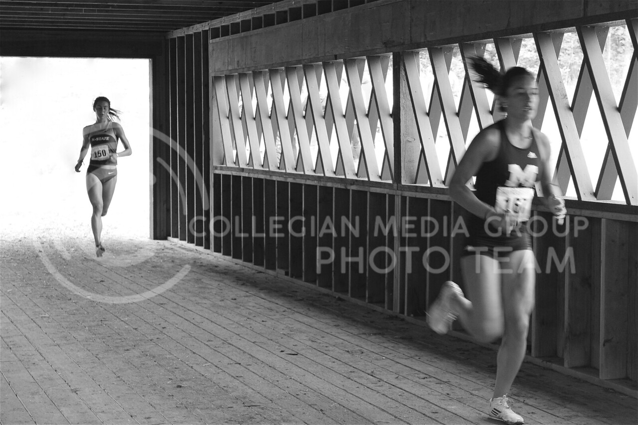 (Photo by Josh Staab   The Collegian)<br /> <br /> Sophomore Mary Frances Donnelly crosses King's Bridge.  She would be the third finisher for K-State and the 13th overall.
