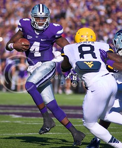 Photo by Jed Barker | The Collegian  K-State quarterback Daniel Sams attempts to maneuver around the West Virginia defense at Bill Snyder Family Stadium on October 26, 2013.