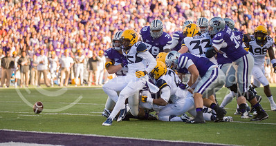 Photo by Emily DeShazer | The Collegian  K-State and West Virginia players scramble for a Daniel Sams fumble on Saturday at Bill Snyder Family Stadium.
