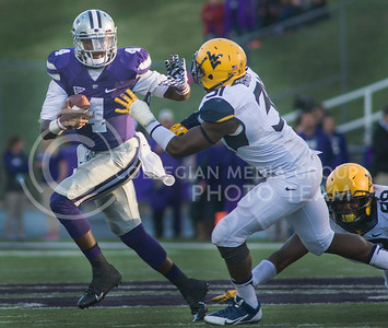Photo by Emily DeShazer | The Collegian  Sophomore quarterback Daniel Sams rushes from sophomore linebacker Isaiah Bruce on Saturday Oct. 26 at Bill Snyder Family Stadium.