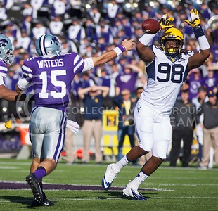 Photo by Jed Barker | The Collegian  K-State quarterback Jake Waters's pass is batted down by West Virginia defensive tackle Will Clarke at Bill Snyder Family Stadium on October 26, 2013.
