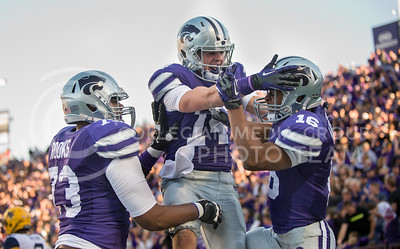 Photo by Emily DeShazer | The Collegian  Senior offensive lineman Tavon Rooks (left) and junior wide receiver Curry Sexton celebrate with Tyler Lockett after his touchdown Saturday afternoon at Bill Snyder Family Stadium.