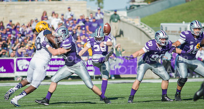 Photo by Emily DeShazer | The Collegian  Senior punter Mark Krause sends a punt down field on Saturday Oct. 26 at Bill Snyder Family Stadium.