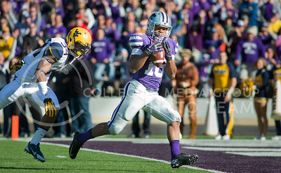 Photo by Emily DeShazer | The Collegian  Junior wide receiver Tyler Lockett (right) catches a touchdown pass from junior quarterback Jake Waters on Saturday Oct. 26 at Bill Snyder Family Stadium.